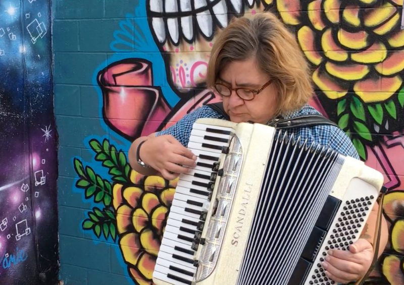 Carolyn Bevington on the Accordion in Freak Alley, Boise, Idaho.